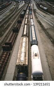 An aerial view of a train leaving the railroad yard