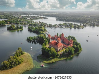 Aerial view of Trakai Castle, located in the middle of Galve lake in Lithuania. Surrounded by beautiful lakes and green smaller islands with plenty of water attractions for tourists available.