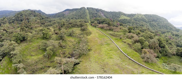 Aerial view of The Trans-Andean oil pipeline passing through montane rainforest in the Ecuadorian Amazon. Transports oil from the Amazon to the coast. Clearings have been cut for cattle ranching.