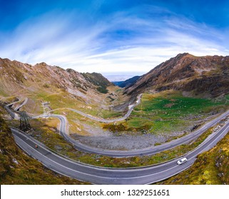 Aerial view of Transfagarasan pass in autumn. Crossing Carpathian mountains in Romania, one of the most spectacular mountain roads in the world. Travel and vacation concept, tour. large panorama