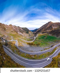 Aerial view of Transfagarasan pass in autumn. Crossing Carpathian mountains in Romania, one of the most spectacular mountain roads in the world. Travel and vacation concept, tour. vertical photo