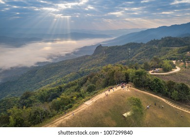 Aerial view of Travelers Thai peoples travel with camping and rest in tent at top of mountain Doi Samer Dao and Pha Hua Sing in Sri Nan National Park, Nan province, Thailand.