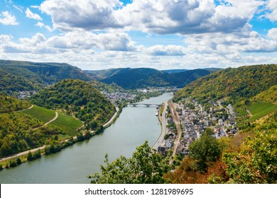 Aerial view of the Treis-Karden municipality, the river Moselle and the surrounding hills on a sunny day. Cochem-Zell, Rhineland-Palatinate, Germany.