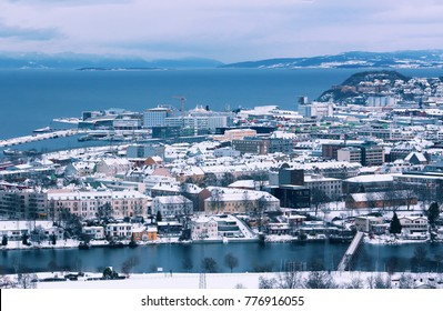 Aerial view of the trondheim fjord, the river Nidelva and the Norwegian city Trondheim at the winter sunrise