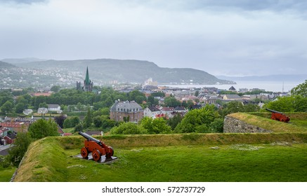 Aerial view at Trondheim town from Kristiansten Fortress in cloudy summer day. Norway.
