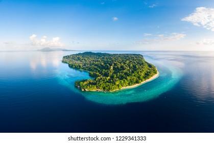 Aerial view tropical beach island reef caribbean sea. Indonesia Moluccas archipelago, Banda Islands, Pulau Ay. Top travel tourist destination, best diving snorkeling.