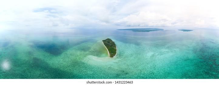 Aerial view tropical beach island reef caribbean sea. Indonesia Wakatobi archipelago, Tomia Island, marine national park. Top travel tourist destination, best diving snorkeling.