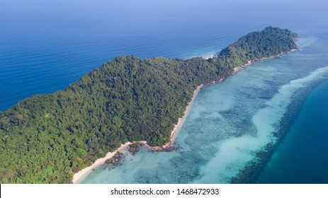 Aerial View of Tropical island named Koh Kradan in Trang, Thailand showing the coral reef along the island
