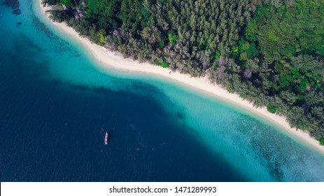 Aerial view of tropical Island white sand beach alonf the pine tree anf turqouise water at Koh Kradan Island, Trang, Thailand. Beach top view.