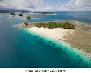 Aerial view of tropical islands and beach in secluded bay