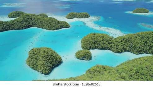 Aerial view of tropical islands and boat in Micronesia