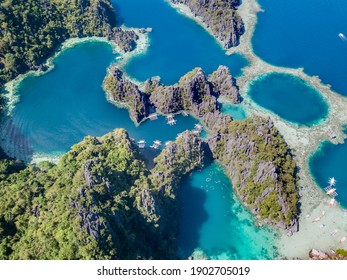 Aerial view of tropical Islands in Coron Palawan Philippines. Drone view of islands surrounded by blue sea.