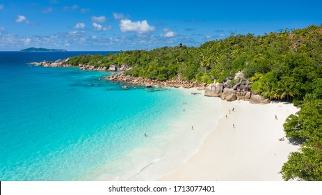 Aerial view of tropical paradise beach with white sand and turquoise crystal clear water of Indian Ocean - Anse Lazio, Praslin Island, Seychelles