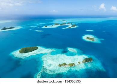 Aerial view of tropical paradise islands, coral reef and clear blue water, Palau, Micronesia