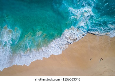 Aerial view to tropical sandy beach and blue ocean wave in Indonesia