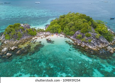 """Aerial view of tropical white sand beach and crystal blue sea near the Lipe Island. """"Kra Island"""" is a group of small rocky islets in the southern area of Andaman sea of Thailand."""