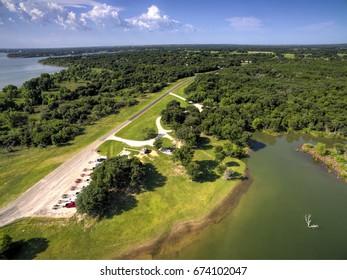 An aerial view of trucks parked at a boat ramp on the Brazos River near Waco Texas