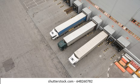 Aerial view of trucks unloading in logostics center