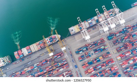 Aerial view tug boat dragging container ship from sea port warehouse for delivery containers shipment. Suitable use for transport or import export to global logistics concept.