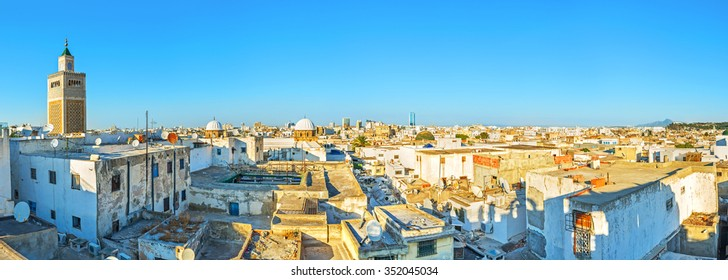 The aerial view of Tunis Medina with the high minaret of the Great Mosque, Tunisia.