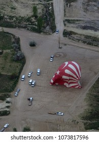 Aerial view of Turkish hot air balloons landing and deflating, Cappadocia, Turkey.