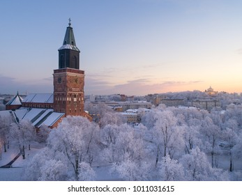Aerial view of Turku Cathedral at winter evening with beautiful frosty trees on foreground, Finland