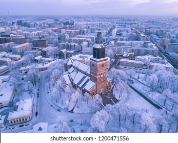 Aerial view of Turku Cathedral at winter with frost covered trees and snow