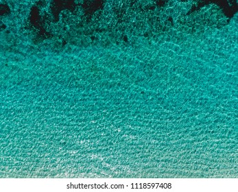 Aerial view of turquoise ocean water. Tropical background