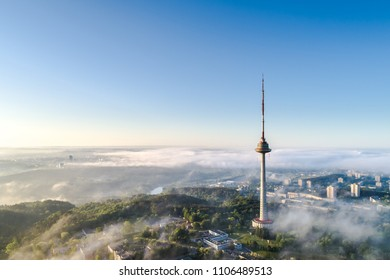 Aerial view of TV tower -highest building in Vilnius city covered by early morning fog