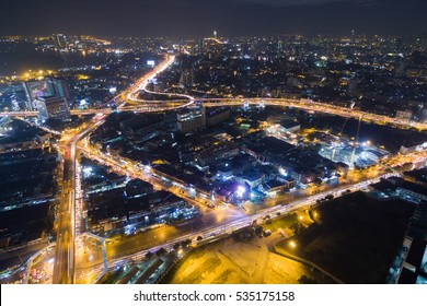 Aerial view at twilight and light of traffic in Bangkok, Thailand.