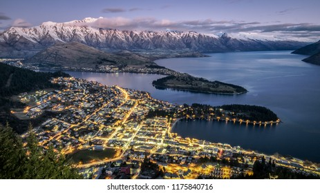 Aerial view of twilight Queenstown. Suitable for tour image. This is the most popular and famous tourist destination and attraction in New Zealand. This image is taken from hill top.