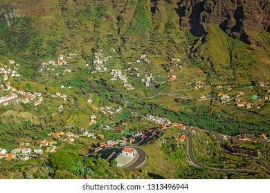 Aerial view of the twisting road going through the stunning and beautiful Valle Gran Rey, La Gomera, Canary Islands, Spain