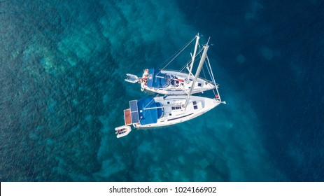 Aerial view of two anchoring yacht in open water. Ocean and sea travel and transportation
