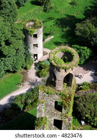 Aerial view of two of Blarney Castles towers and the lush green surroundings
