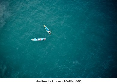 Aerial view of two fishers boats in the turquoise waters in Kerala, India