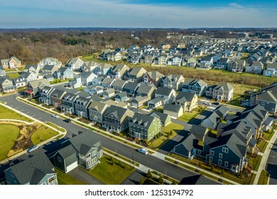 Aerial view of typical american colonial single family luxury home real estate neighborhood for upper middle class families in the USA