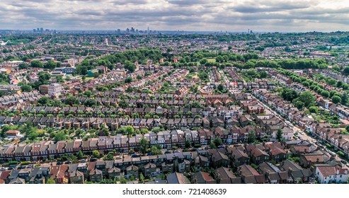 Aerial view of a typical Edwardian Victorian village with the skyline of the City of London in the background