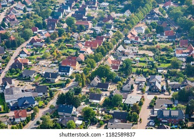 Aerial view of a typical German suburb with detached houses and close neighbourhood, flight with a gyroplane