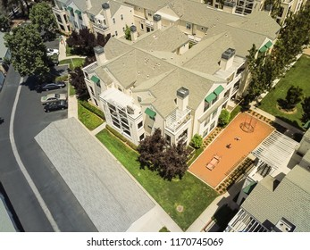 Aerial view typical multi-level apartment homes with playground in Cupertino, Silicon Valley, California, cloud blue sky