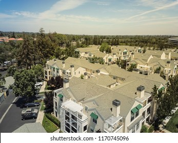 Aerial view typical multi-level apartment complex in Cupertino, Silicon Valley, California, cloud blue sky