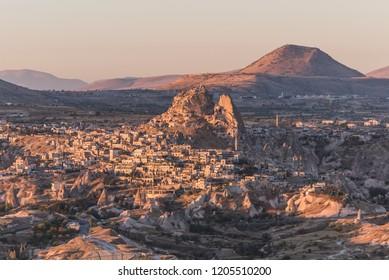 Aerial view of Uchisar and Kalu Tepeleri during sunrise in the morning, Nevşehir, Cappadocia, Turkey