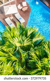 Aerial view of Umbrella and chair around beautiful luxury swimming pool in hotel resort