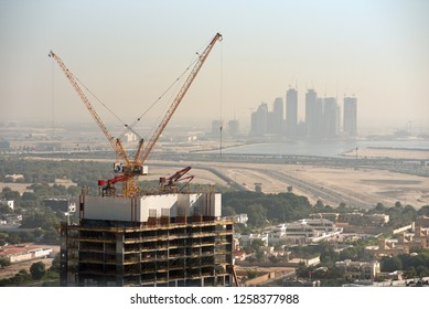 Aerial view of under construction building with cranes from downtown, visible whole Zabeel district, Dubai Creek harbor, Dubai Canal to Business Bay and Al Khail road