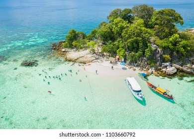 Aerial view of Unidentified tourists enjoy and relax on the white sand beach at Koh Rok Roy or Koh Rokroy (Rok Roy Island), Lipe Island, Tarutao National Marine Park, Satun Province, Thailand.