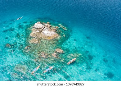 Aerial view of unidentified tourists snorkeling activity on tropical island near Lipe Island, Satun, Thailand.