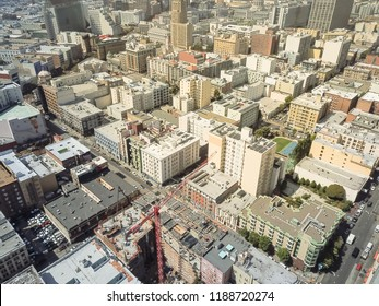 Aerial view Union Square and Civic Center, Tenderloin neighborhood, San Francisco, California, America. Cityscape dense skyline and building under construction with working red crane