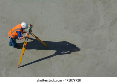 Aerial view of unrecognizable land surveying in construction site. copy space