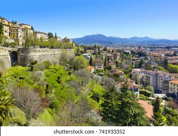 Aerial view of upper and lower cities of Bergamo, Italy with medieval wall