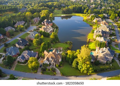 Aerial view of an upscale subdivision in suburbs in Georgia shot during golden hour