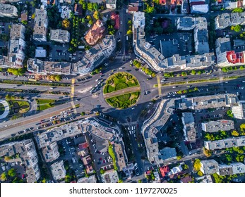 Aerial view of a urban road roundabout. Trafic jam in the city. Urban aerial view. Birdeye view in the city over the streets and blocs. Road trafic in the city. Cars on the streets of Ploiesti city.
